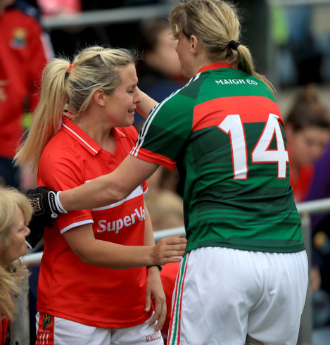 Cora Staunton consoles Brid Stack of Cork at the end of the game
