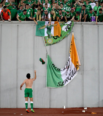 Shane Long throws his jersey into the crowd