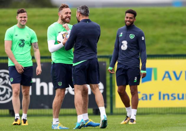 Richard Keogh shares a joke with Jonathan Walters