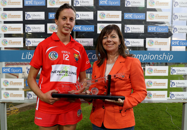 Orla Cotter is presented with the Liberty Insurance player of the match by Deirdre Ashe of Liberty Insurance