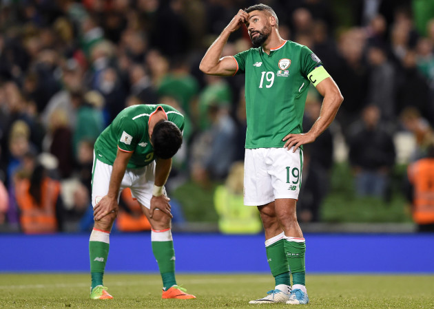 Jonathan Walters and Shane Long dejected after the game