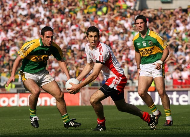 Justin McMahon watched by Declan O'Sullivan and Byran Sheehan