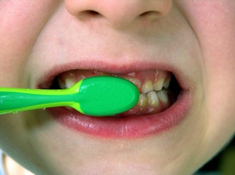 Child brushes his teeth