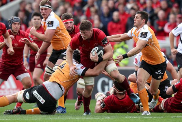 Jack O'Donoghue is tackled by Rynier Bernardo