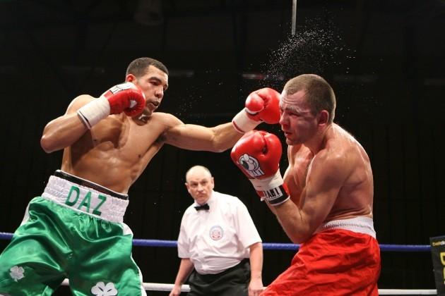 Darren Sutherland lands a punch on Siarhei Navarka