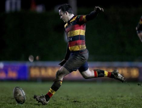 Scott Deasy kicks a penalty
