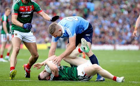 Eoghan O'Gara with Colm Boyle
