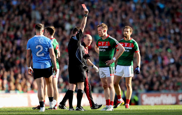 Donal Vaughan receives a red card from referee Joe McQuillan after a strike on John Small