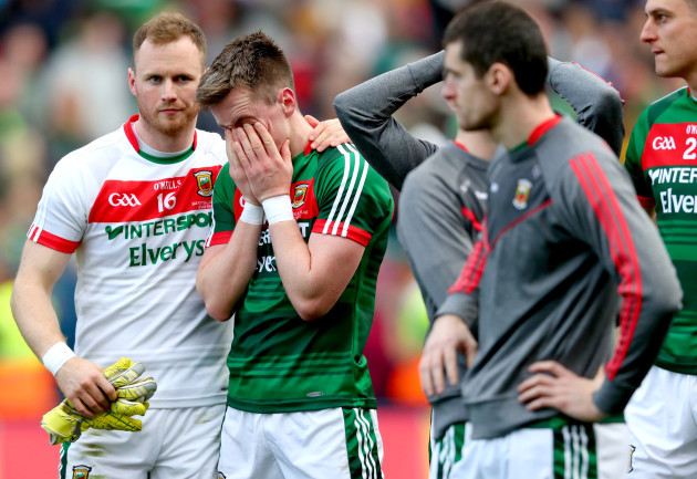 Robert Hennelly consoles Cillian O'Connor