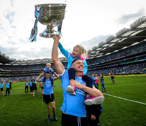 Eoghan O'Gara celebrates with his daughter Ella and The Sam Maguire
