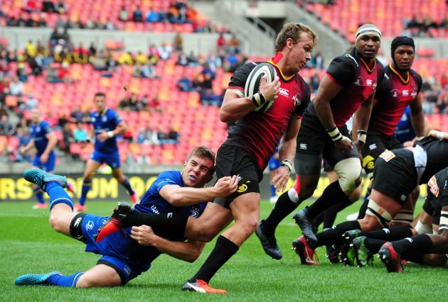 Rudi van Rooyen is tackled by Luke McGrath
