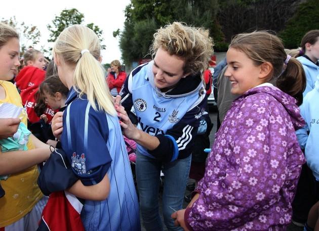 Rachel Ruddy signs autographs for fans