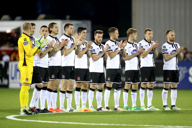 Dundalk players observe a minutes applause for Jimmy Magee
