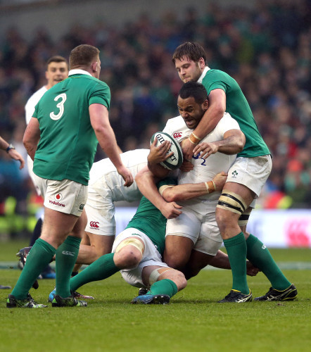 Billy Vunipola is tackled by Iain Henderson and Sean O'Brien