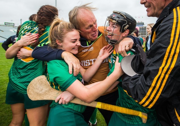 John Davis celebrates after the game with Fia O'Brien and Louise O'Donoghue