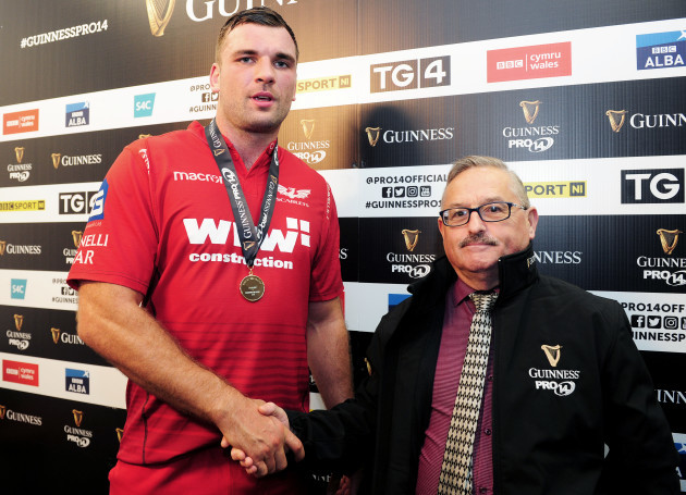 Tadhg Beirne is presented with the Guinness PRO14 man of the match award by Howard John