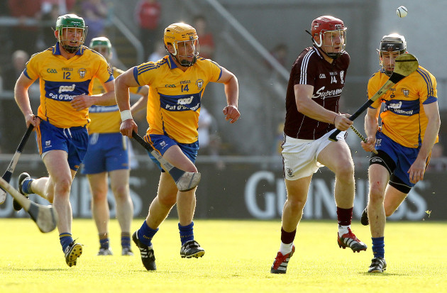 Joe Canning gets away from Diarmuid McMahon, John Conlon and Patrick Donnellan
