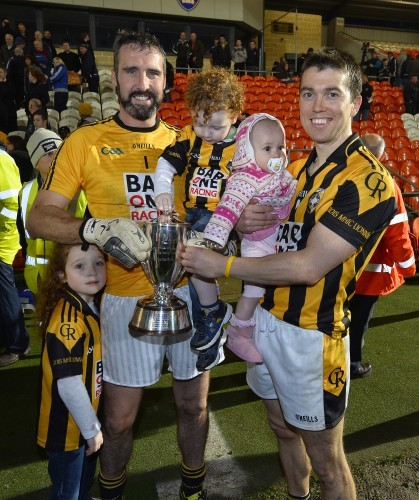 Paul Hearty with his children Breanne and Oran and Stephen Kernan with his daughter Sophie with the Gerry Fagan Cup