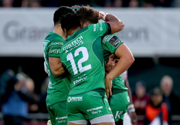 Tom Farrell celebrates with Bundee Aki and Tiernan O'Halloran
