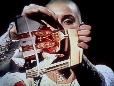 Image result for sinead o'connor tearing up picture of pope""