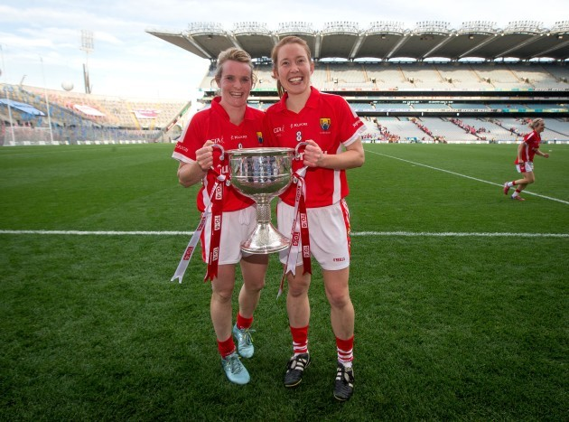 Briege Corkery and Rena Buckley celebrate with the Brendan Martin Cup