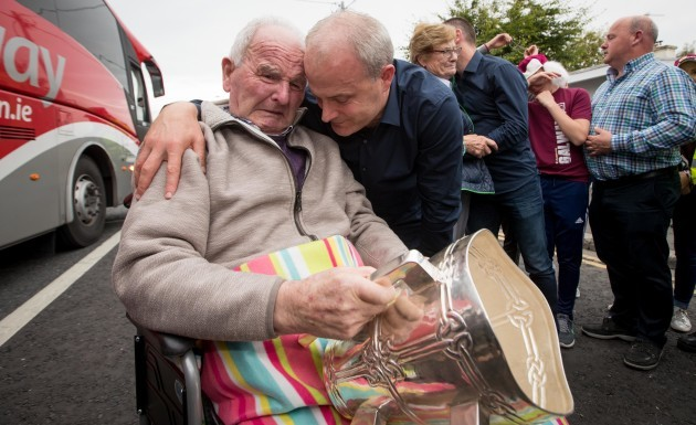 Micheal Donoghue shows the Liam McCarthy to his father Miko Donoghue for the first time