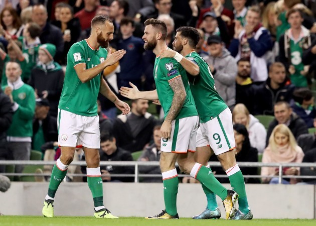 Daryl Murphy celebrates scoring a goal with Shane Long and David Meyler