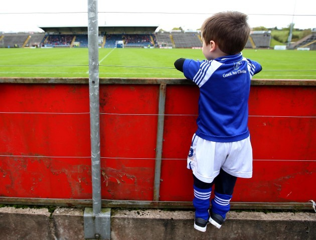 Odhran Graham climbs to see the pitch before the game