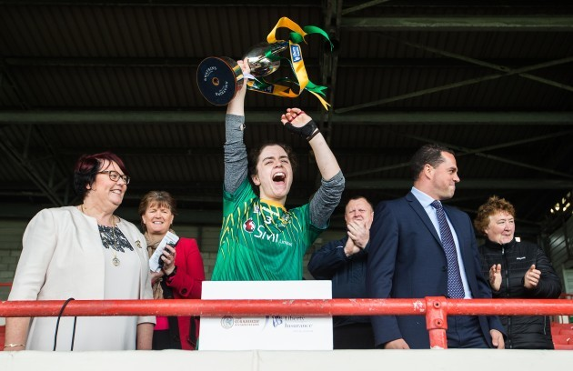 Claire Coffey lifts the trophy