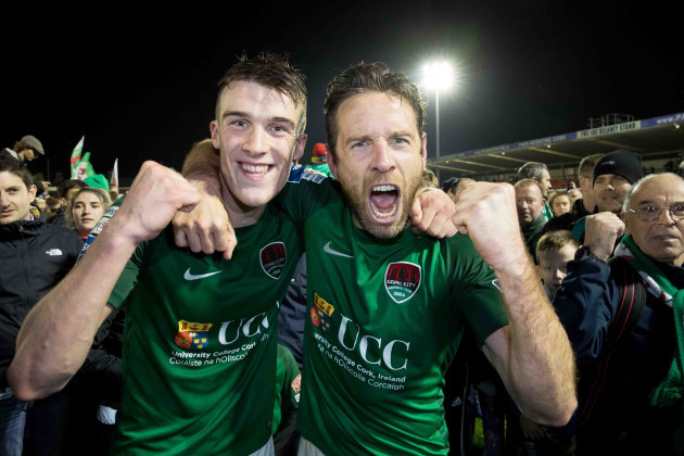 Ryan Delaney and Alan Bennett celebrate winning the league with supporters