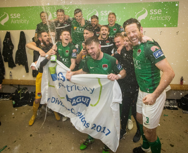Cork celebrate in the dressing room after winning The SSE Airtricity League