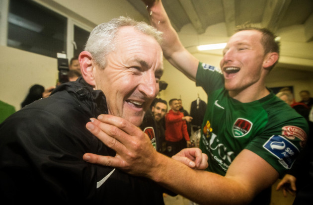 John Caulfield celebrates in the dressing room after the game