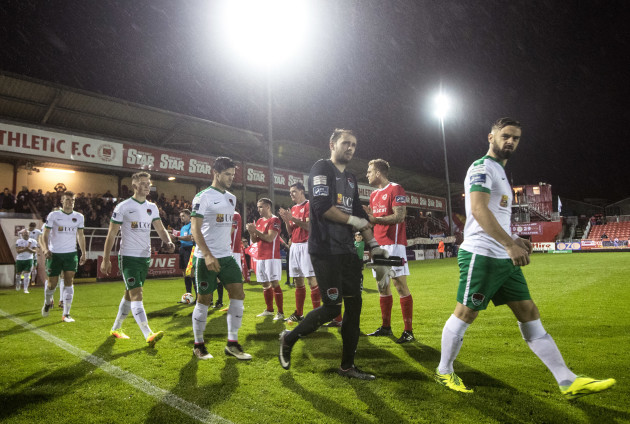 Greg Bolger leads his team out as St. Pat's players form a guard of honour