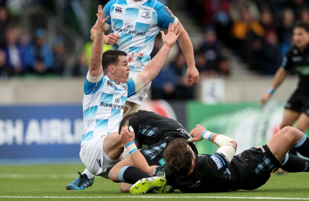 Johnny Sexton appeals to the referee as he's tackled by Peter Horne and Jamie Bhatti