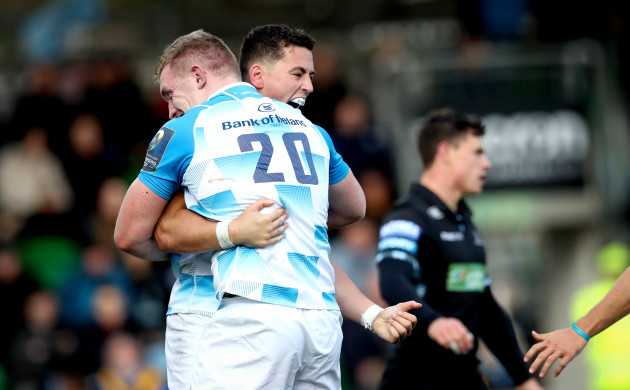 Noel Reid celebrates scoring their fourth try of the game with Dan Leavy