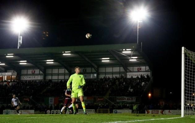Patrick McEleney lobs the ball over Conor Winn