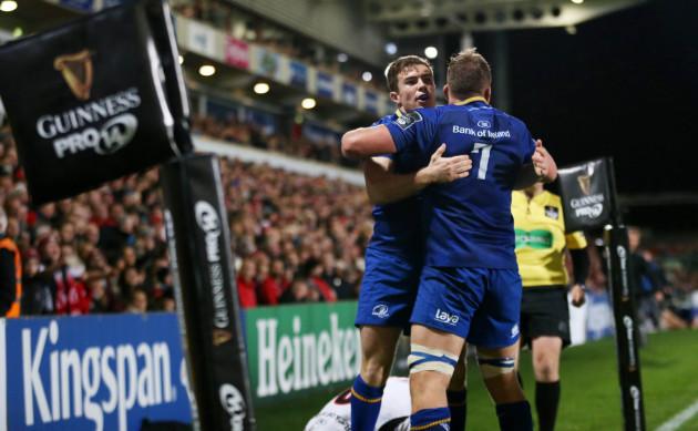 Luke McGrath celebrates his try with Jordi Murphy
