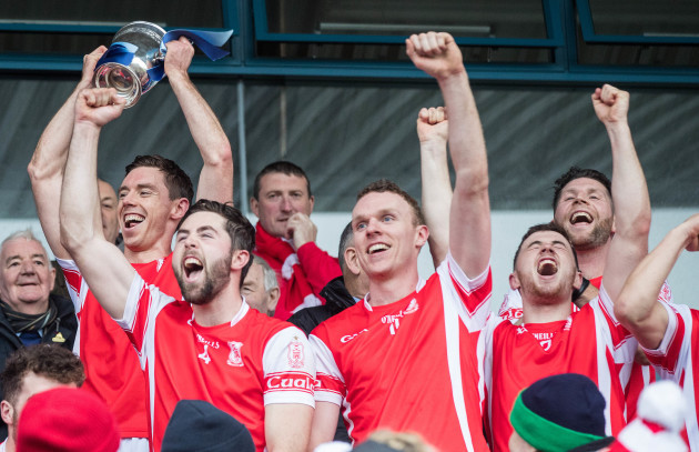 Cuala celebrate with the trophy