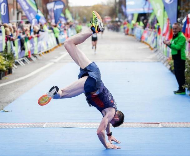 Killian Nolan cartwheels over the finish line