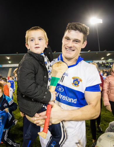 Diarmuid Connolly celebrates with team mascot Marcus Brady