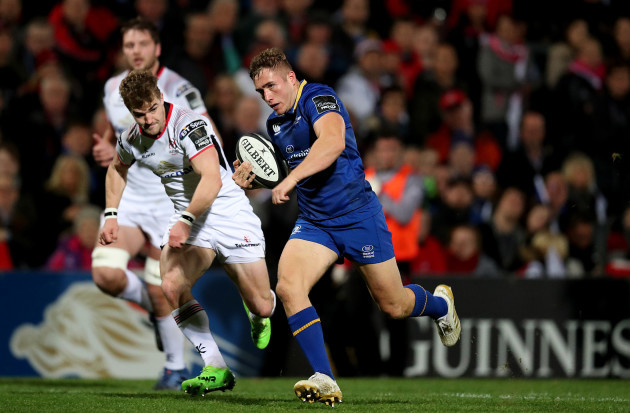 Leinster's Jordan Larmour runs in to score a try from Ulster's Aaron Cairns