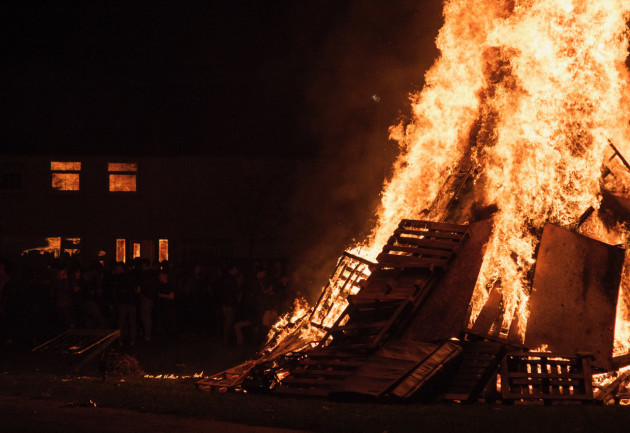 A house reflects the bonfire that is raging in front on Halloween night in Dublin