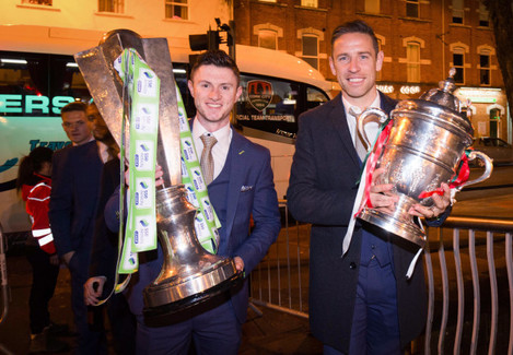Alan Bennett and John Dunleavy with The Irish Daily Mail FAI Cup and SSE Airtricity League Trophy
