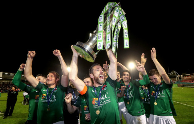 Alan Bennett raises the trophy to the Cork fans with his teammates