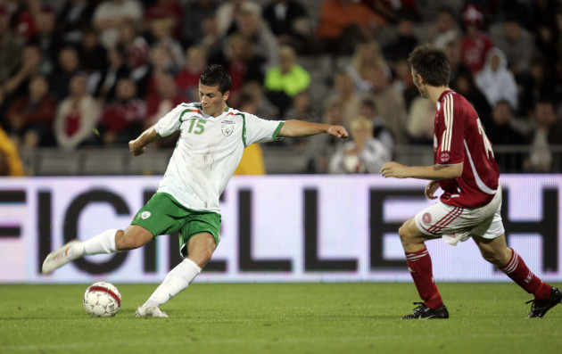Shane Long gets a shot away