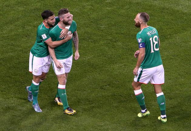 Daryl Murphy celebrates his first goal with Shane Long and David Meyler