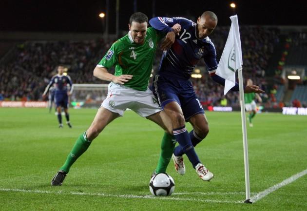 John O'Shea with Thierry Henry