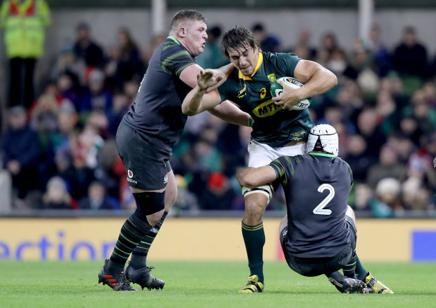 Eben Etzebeth is tackled by Tadhg Furlong and Rory Best