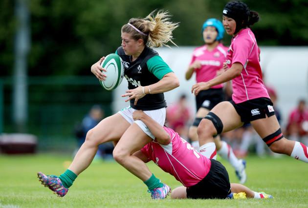 Ailsa Hughes scores a try despite Noriko Taniguchi