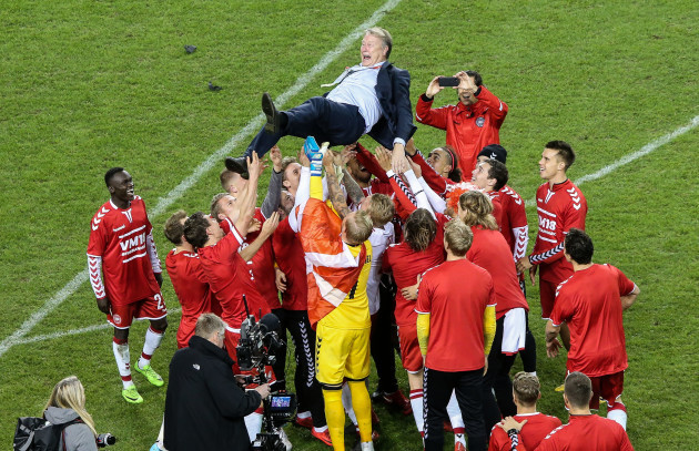 Denmark players celebrate with Aage Hareide